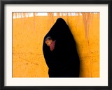 A Veiled Woman Carries Her Child Through the Streets of Erfoud Framed Photographic Print