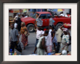 An Water Vendor Walks in the Streets of Port-Au-Prince, Haiti Framed Photographic Print
