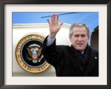 U.S. President George W. Bush Waves as He Steps out of the Air Force One Framed Photographic Print