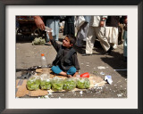 Afghan Child 5, Receives a Bottle of Water Framed Photographic Print by Musadeq Sadeq