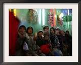 Afghan Boys Watch a Movie on a Television, Unseen, as They Eat Ice Cream at an Ice Cream Shop Framed Photographic Print by Rodrigo Abd