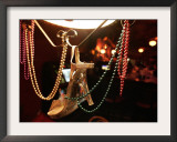 A Woman's High Heeled Shoe Hangs with Some Mardi Gras Beads Framed Photographic Print