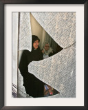 A Family are Seen Through the Shattered Window of Their House Framed Photographic Print