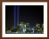 The Twin Lights Memorial Rises Above the New York City Skyline from the Waterfront Framed Photographic Print