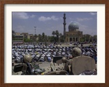 A Crowd of Iraqi Protesters Pray in Front of a U.S. Military Checkpoint Framed Photographic Print