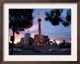 Traffic Passes by the Angel of Independence Monument in the Heart of Mexico City Framed Photographic Print by John Moore