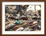 Kashmiri Eartquake Survivors Pray Amid the Debris of a Destroyed Building During the Eid Al-Fitr Framed Photographic Print