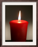 A Scented Votive Candle Burns Framed Photographic Print