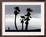 A Man Looks out Towards the Ocean as a Winter Rain Storm Falls on Seal Beach Framed Photographic Print