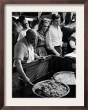 A Vendor Fries Zeppoles as Customers Wait Framed Photographic Print
