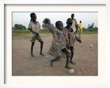 Children Play with Homemade Soccer Balls Made from Discarded Medical Gloves Framed Photographic Print