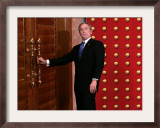 President George W. Bush as He Tries to Open a Locked Door Leaving a Press Conference in Beijing Framed Photographic Print
