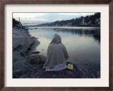A Hindu Pilgrim Meditates Along the Bank of the Ganges River Framed Photographic Print