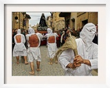 Several Masked Penitents Beats Their Backs During &quot;Los Picaos&quot; Brotherhood Procession Framed Photographic Print