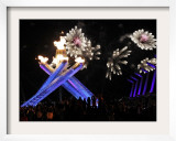 Surrounding the Olympic Flame as Fireworks Explode after the Opening Ceremony of 2010 Winter Games Framed Photographic Print