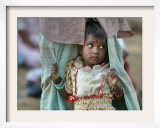 A Displaced Tamil Child Hangs to Her Father's Sarong Framed Photographic Print by Gemunu Amarasinghe