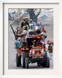 A Pakistan Earthquake Survivor Family Ride a Vehicle as They Make Their Way to Mansehra Framed Photographic Print