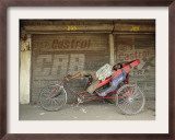 Indian Rickshaw Puller Rests in the Shade at a Closed Market Complex in New Delhi, India Framed Photographic Print