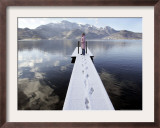 A Young Girl Enjoys the Sunny Winter Weather Framed Photographic Print by Christof Stache