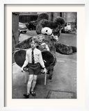 A Boy Gives a Ride to a Little Girl and a 9-Foot Teddy Bear at the Opening of the British Toy Fair Framed Photographic Print
