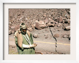 An Injured Pakistani Man Walks on an Earthquake-Damaged Mountain Pass Road Framed Photographic Print