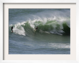 Surfers Ride a Large Wave of Sydney's Manly Beach Framed Photographic Print