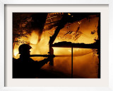 A Firefighter Tries to Extinguish a Raging Fire Framed Photographic Print