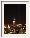 Empire State Building in Red, White and Blue as Columns of Light Soar from World Trade Center Site Framed Photographic Print