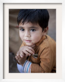 Boy Waits to Receive a Ration of Donated Rice at Food Distribution Center in Islamabad, Pakistan Framed Photographic Print