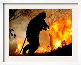 A Fire Fighter Retreats from a Forest Fire Near Fraldeu, Central Portugal Framed Photographic Print