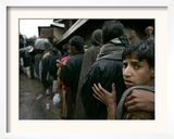 Pakistanis Wait in Line to Receive Food as Aid Framed Photographic Print
