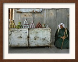 A Palestinian Sits Near the Stand of a Street Seller Displaying Goods for Sale Framed Photographic Print