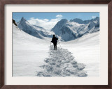 A Lone Mountain Hiker Walks in the Snow, Formazza Valley, Northern Italy Framed Photographic Print by Fabio Polimeni