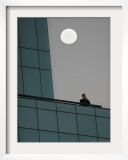 The Moon Rises as a Smoker Has a Cigarette on the Balcony, Johannesburg, Monday August 7, 2006 Framed Photographic Print by Denis Farrell