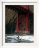A Surfer is Dwarfed by the Northern End of the Golden Gate Bridge While Riding the Waves Framed Photographic Print