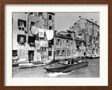 A Man Takes His Boat Through the Canal Framed Photographic Print