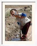 A Young Internally-Displaced Child at a Camp for Displaced Iraqis Who Have Fled Violence Framed Photographic Print