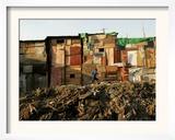 A Child Runs by a Row of Shacks in Novo Mundo Shantytown, Sao Paulo, Brazil Framed Photographic Print