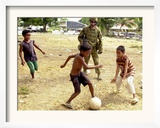 An Australian Soldier Plays with Displaced East Timorese Children Framed Photographic Print