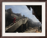 Indonesian Rescue Workers Walk on a Eartquake Damaged Building, in Padang, Indonesia Framed Photographic Print