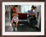 Japanese Commuters Framed Photographic Print by David Guttenfelder