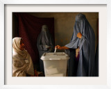 An Afghan Woman Wearing a Burqa Casts Her Ballot at a Polling Station Framed Photographic Print