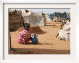 A Girl Washes Plates for Her Family in the North Darfur Refugee Camp of El Sallam October 4, 2006 Framed Photographic Print by Alfred De Montesquiou