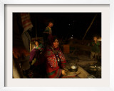A Kuchi Woman Prepares Tea Where Her Family Sets Camp on the Outskirts of Kandahar Framed Photographic Print