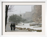 Two Priests Walk in Snow in Front of the Jaffa Gate in Jerusalem&#39;s Old City, December 27, 2006 Framed Photographic Print by Oded Balilty