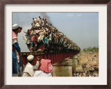 Hundreds of Muslim Pilgrims Ride on a Train Passing on a Bridge at Gazipur Framed Photographic Print