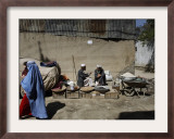 Afghan Street Vendor Speaks with Friend as He Sells Mulberry Pea Nuts and Sun Flower Seeds in Kabul Framed Photographic Print