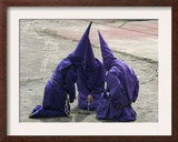 Cucuruchos Pray Before an Easter Procession Framed Photographic Print