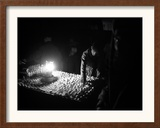 An Afghan Vendor Sells Eggs by Lantern Light Framed Photographic Print