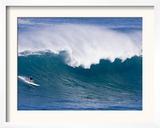 A Surfer Rides a Wave at Waimea Beach Framed Photographic Print